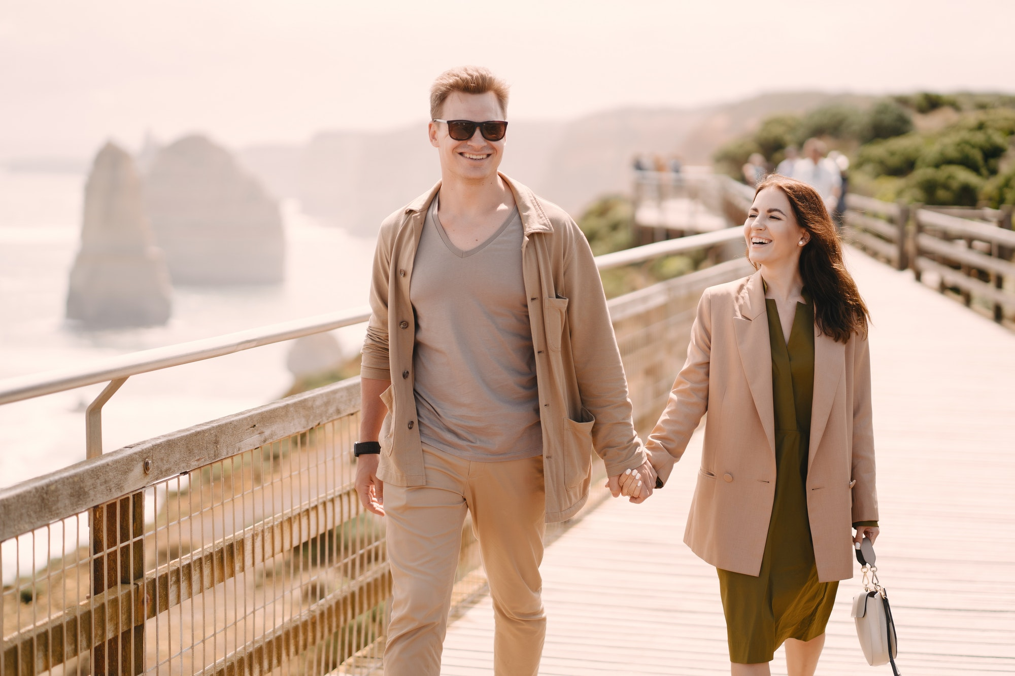 Couple on vacation wlking on a bridge